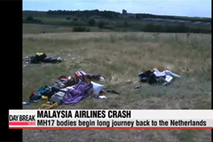 Victims of Malaysia plane downing begin long journey home