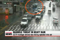Be aware of manhole covers during heavy rain