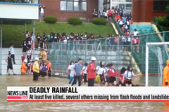 Record rainfall and flash floods leave 14 dead or missing