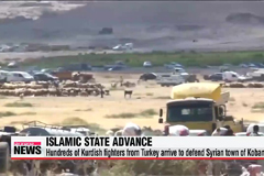Syrian Kurds flee to Turkey in fear of Islamic State advance