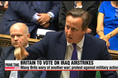 Britain's PM urges parliament to back air stirkes in Iraq