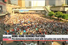 Pro-democracy sit-ins in Hong Kong persist into early Monday