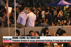 Hong Kong protesters threaten to occupy gov't buildings if chief executive does not resign