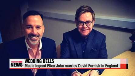 Elton John weds partner David Furnish