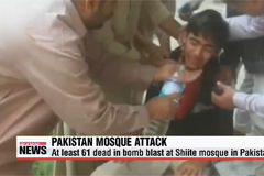 At least 61 dead in bomb blast at Shiite mosque in Pakistan