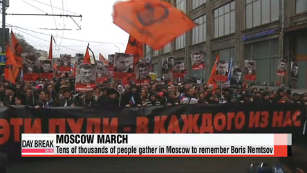 Tens of thousands march in Moscow in honor of slain Kremlin critic Boris Nemtsov.