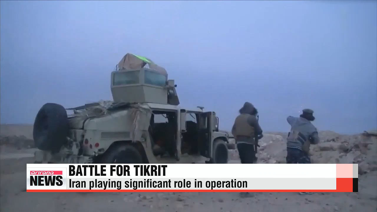 Iraqi forces battle IS militants for Tikrit