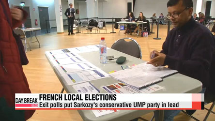 Exit polls hand Sarkozy's conservative UMP party election win