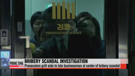 Prosecutors grill aide to late businessman at center of bribery scandal