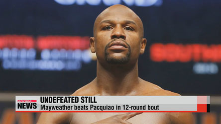Mayweather beats Pacquiao in 12-round bout