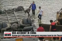 At least 11 dead after bus carrying Korean officials plunge in China