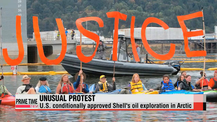 Activists demonstrate from Portland bridge against Shell